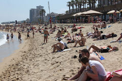 Crowded beach with tourists and locals in s Stock Photos