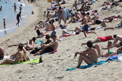 Crowded beach with tourists and locals in s Stock Image