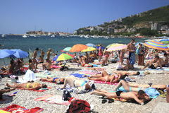 Crowded beaches of Budva Stock Photos