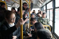 Crowded bus in Beijing China. Beijing, CHINA - 23 MAR, 2018: The bus carriage were crowded with passengers in Beijing China Stock Photo