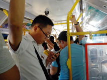 The crowded bus carriages were crowded with passengers. In Shenzhen, China Royalty Free Stock Photos