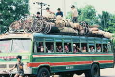 Crowded bus in rural Vietnam. Crowded bus loading cargo in southern Vietnam Stock Photo