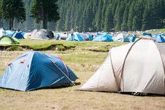 Crowded camping in a valley Royalty Free Stock Images