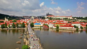 Crowded The Charles Bridge and Vltava river shore stock video