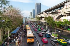 Crowded Chatuchak market area in Bangkok. BANGKOK, THAILAND, APRIL 09, 2017 : Busy area of the Chatuchak week-end market with spring blossom, Bangkok, Thailand Royalty Free Stock Image