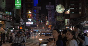 Crowded Chinatown with dense traffic at night, Bangkok. BANGKOK, THAILAND - NOVEMBER 02, 2015: Night view of Chinatown district. Crowded streets and busy road stock video
