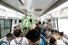 Crowded Chinese metro. People traveling on a crowded Chinese metro royalty free stock photos