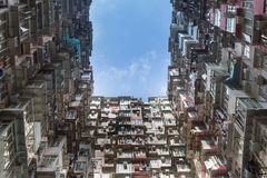 Crowded city apartment from bottom view. Against blue sky Royalty Free Stock Photos
