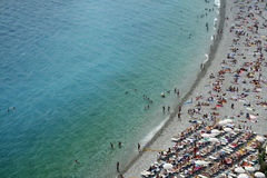 Crowded city beach nice france Stock Photo