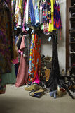 Crowded Clothing Racks And Piled Shoes Stock Photography