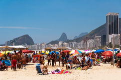 Crowded Copacabana beach on hot summer day, Rio de Janeiro, Brazil Stock Photos