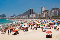 Crowded Copacabana beach on hot summer day, Rio de Janeiro, Brazil Royalty Free Stock Photography