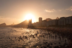 Crowded Copacabana Beach by Sunset in Rio de Janeiro, Brazil Royalty Free Stock Image