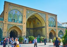 The crowded courtyard of Shah`s Mosque, Tehran. TEHRAN, IRAN - OCTOBER 11, 2017: The courtyard of Shah`s Mosque is always crowded, here come numerous locals and Royalty Free Stock Photography