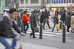 Crowded downtown. Image of the crowd in a downtown crossing street area Stock Photo