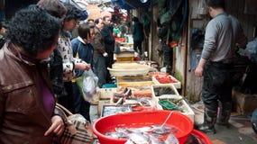 Crowded fish market stall, China