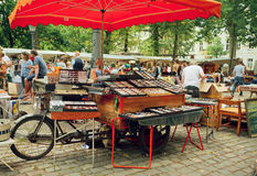 Crowded flea market with creative stands of vintage glasses and merchandise Royalty Free Stock Photo