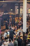 The crowded Food Hallen. Amsterdam, Netherlands - 21 November, 2015: View of the bulls and dogs stand at the food hall of the De Hallen event hall on the Royalty Free Stock Images