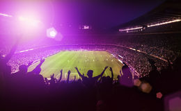 Crowded football stadium. With lens flare Stock Images
