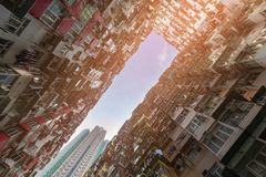 Crowded Hong Kong city apartment bottom view royalty free stock photography