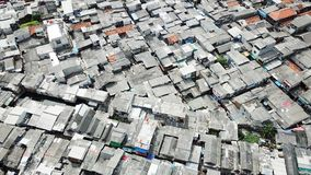 Crowded houses in slum neighborhood area. Aerial scenery of crowded houses in slum neighborhood area at North Jakarta, Indonesia Royalty Free Stock Images