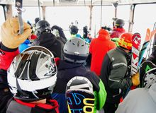 Crowded inside the ski gondola