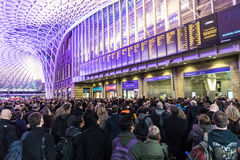 Crowded Kings Cross station in London. LONDON, UK - FEBRUARY 23, 2017: Crowded Kings Cross station in the city. Hundreds people waiting for the train, with Royalty Free Stock Photography
