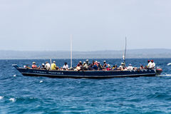 A crowded local fishing boat sailing in the Indian ocean, Tanzania, Africa Stock Photos