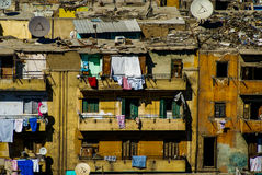 Crowded low income apartment living. Apartment living in the city Royalty Free Stock Images