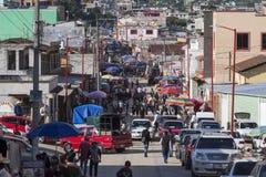 Crowded main avenue in downtown San Juan Chamula. SAN JUAN CHAMULA, CHIAPAS, MEXICO - JUNE 23, 2018: The main avenue in downtown San Juan Chamula becomes a stock photography