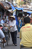 Crowded marketplace with street vendor in Ho Chi Minh City royalty free stock photos