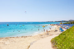 Crowded Mediterranean summer beach Stock Photos