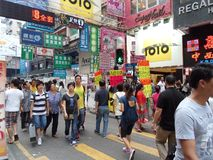 Crowded Mongkok Street. A crowded street in Mongkok district of Hong Kong with many people and many signs Royalty Free Stock Photography