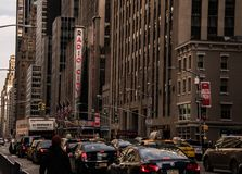 Crowded New York avenue with a view of Radio City Music Hall royalty free stock photography