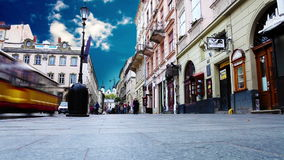 Crowded old city street with time lapse sky. Lviv,Ukraine stock video footage