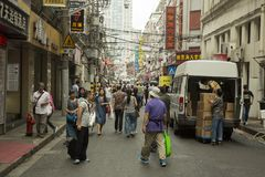 Crowded street in Shanghai, China. Crowded old street in downtown Shanghai, China Royalty Free Stock Photo