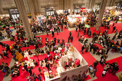 Crowded panoramic view of an indoor exhibition Royalty Free Stock Images