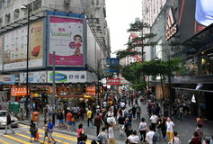 Crowded pavement, shops and people at Causeway Bay Train Station. Stock Photography