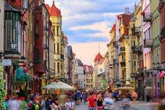 Crowded pedestrian street in european town Torun, Poland Stock Photos