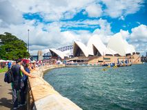 Crowded people on Australia day at Opera House, the image was taken from the east side of it in the Cloudy day. SYDNEY, AUSTRALIA. – On January 26, 2016 stock photos
