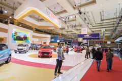 Crowded people buying new car at the exhibition Royalty Free Stock Image