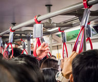 Crowded people in public transportation Stock Images