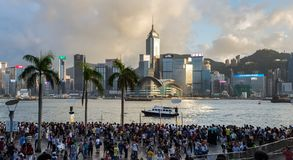 Crowded people waiting National Day Fireworks Display in rain at waterfront of Victoria Harbour of Hong Kong Royalty Free Stock Images