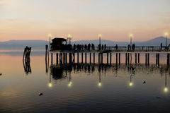 Crowded pier at evening Stock Photos