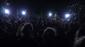Crowded place with people partying at a rock concert stock footage