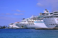 Crowded Port. Cruise ships docked in busy Bahamian port Stock Photo