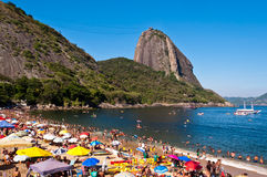 Crowded Red Beach with view of Sugarloaf Mountain in Rio de Janeiro, Brazil royalty free stock photos