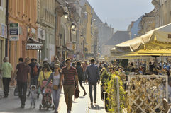Crowded Republicii Street in Brasov, Romania royalty free stock photos