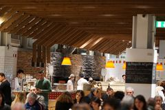 Crowded restaurant interior. Rome, Italy - December 22, 2017: crowded Eataly restaurant interior. Eataly is the upscale food emporium chain; Rome branch opened stock images