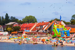 Crowded sandy beach Stock Photos